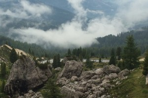 The storm clears and in the distance, Loren and Jim descend the Passo di Valporola.