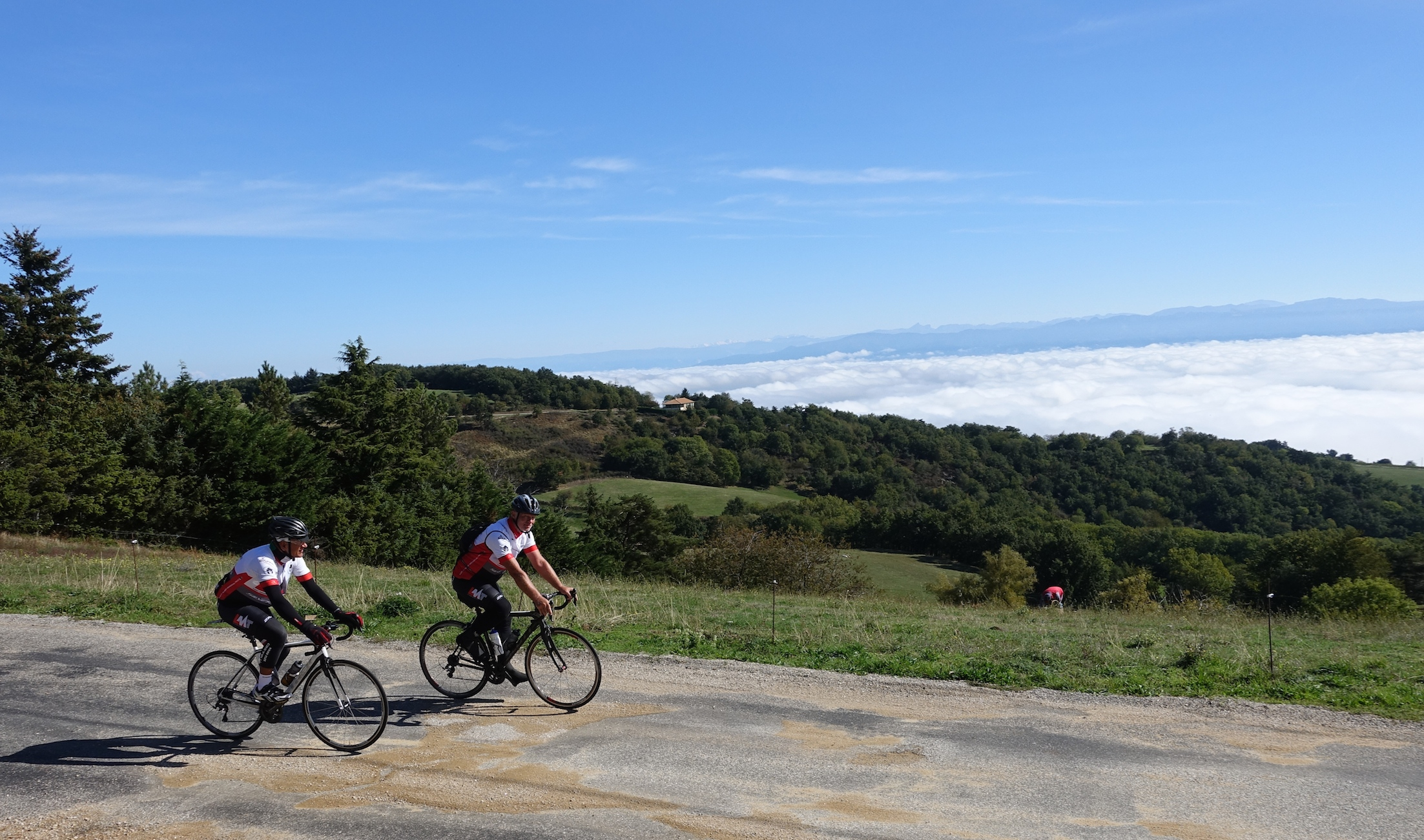 Allan Greenfield and Thomas Fabe, c.4 hours into the stage. Below them, the Rhone Valley has a cloud inversion!