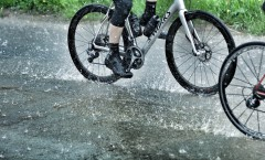 My wheels. This is not a puddle, nor is it a river crossing. It's just the road in one of the downpours.