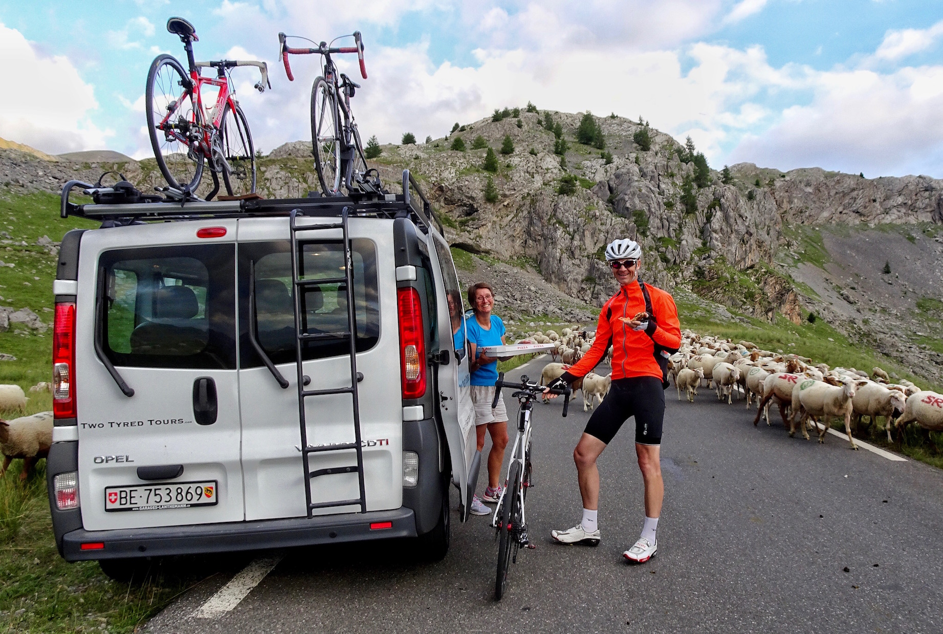 That moment when you've been riding your bike for 18 hours and your support team drives a 50km round trip to bring you pizza! Even better, the road is blocked by sheep, so you have time to savour it!!! Two Tyred Tours - undoubtedly the best bespoke cycle guides in the world!