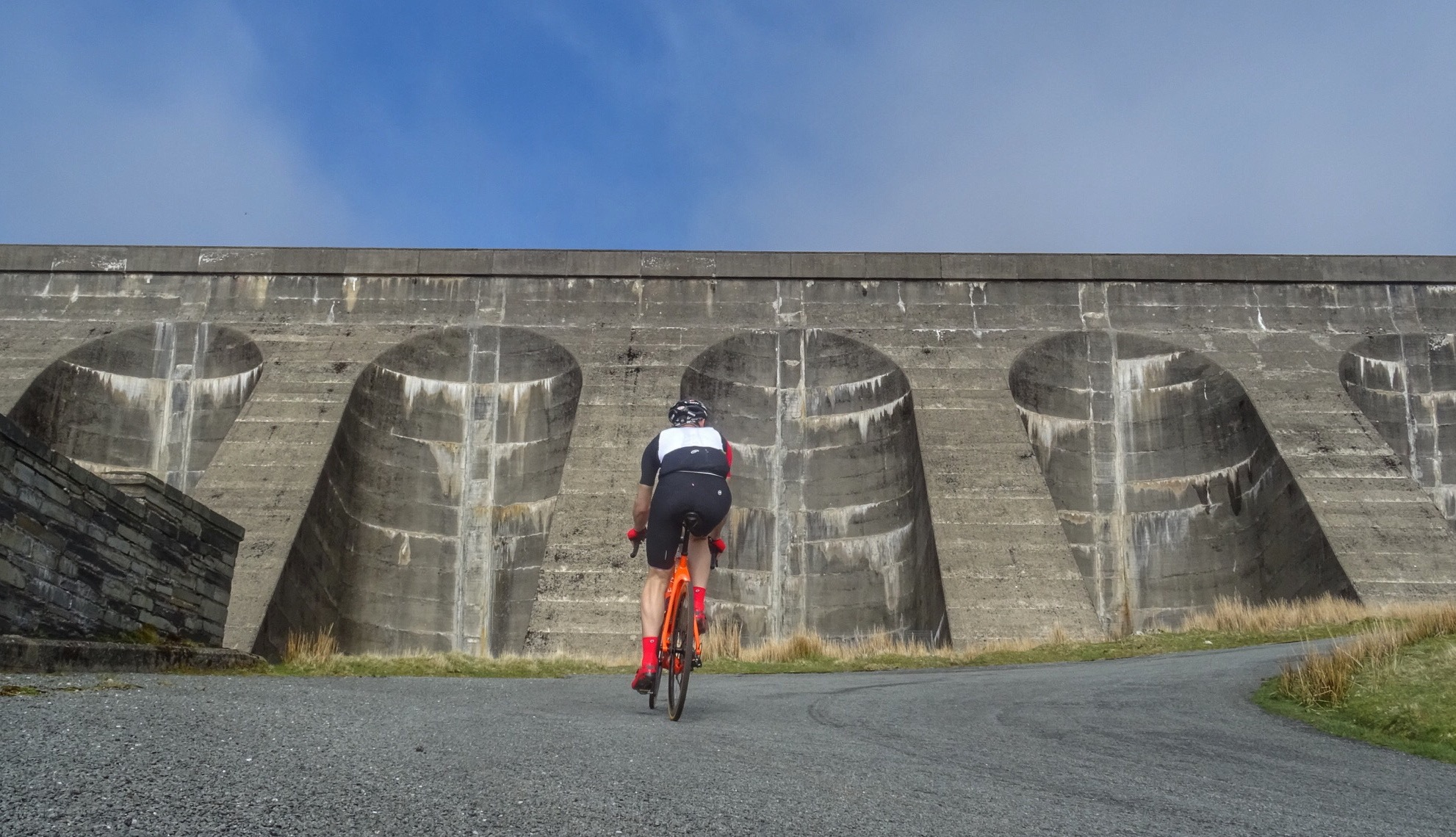 Ride up the very steep road until you get to the dam. Take the right fork and keep going until the road runs out. Simple.