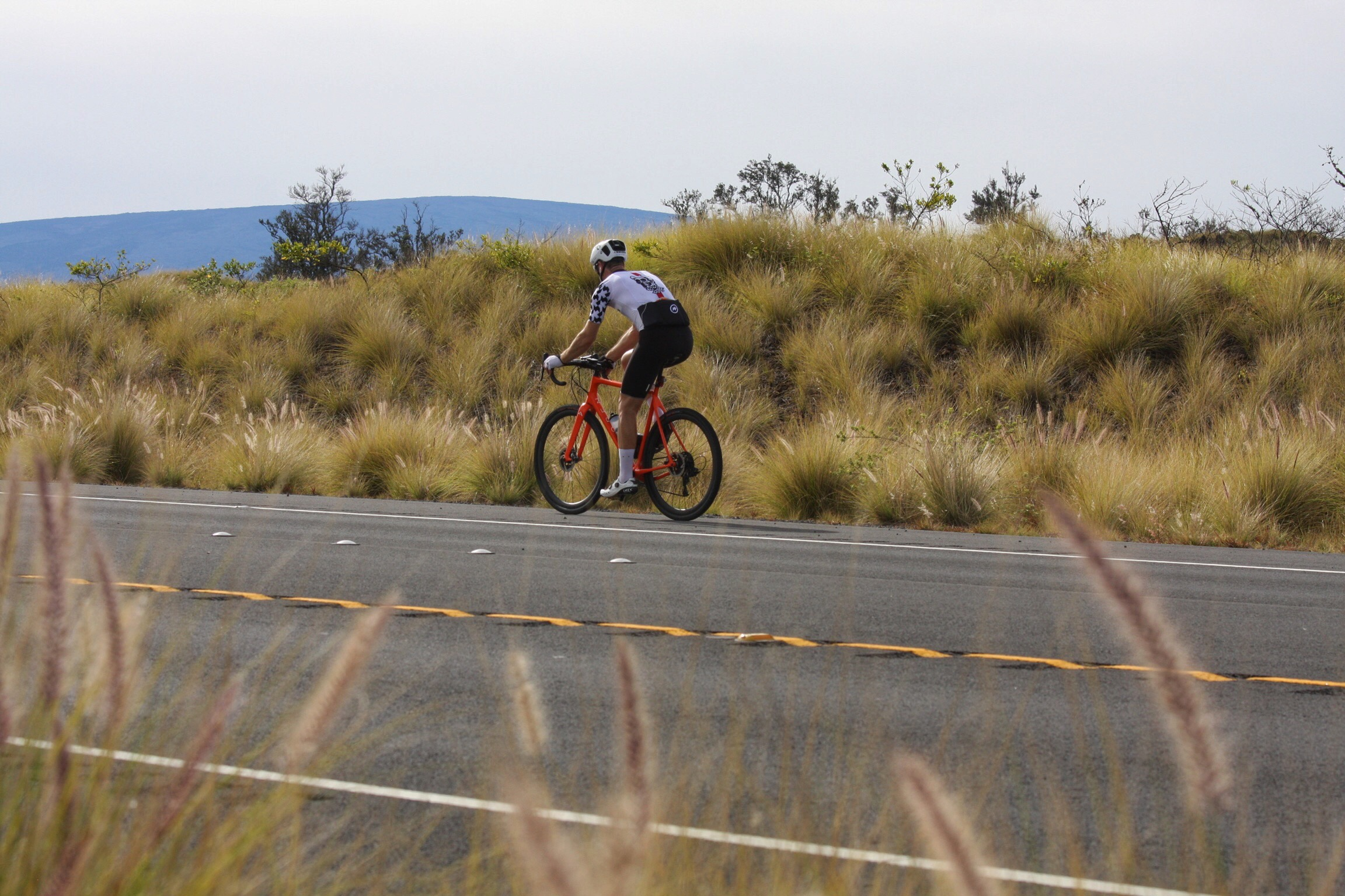 Less than an hour into the ride, on the Waikoloa Road, fighting a strong headwind. Mauna Loa looms in the background.